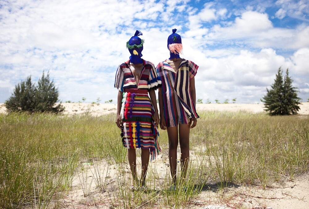 Two models wear dresses from summer collection in nature
